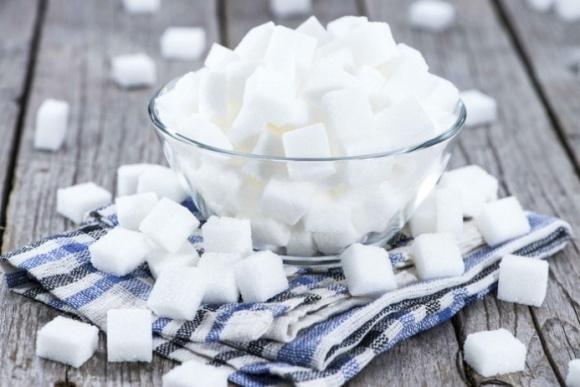 Т. Кутовий вражений динамікою збільшення експорту цукру фото, ілюстрація