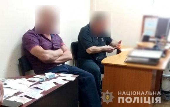 Затримали начальника районного Держгеокадастру під час отримання хабаря фото, ілюстрація