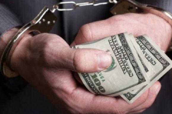 10 тыс. долл. США взятки — на Днепропетровщине подозревают чиновника управления Госгеокадастра  фото, иллюстрация