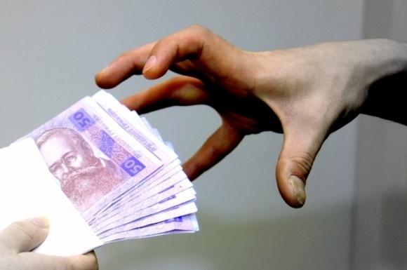 На Сумщине задержали председателя сельсовета за взятку за аренду земучастка фото, иллюстрация