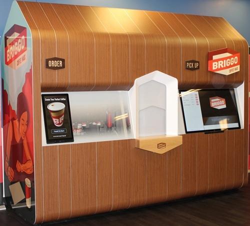 Робот-бариста готує 100 чашок кави за 60 хвилин фото, ілюстрація