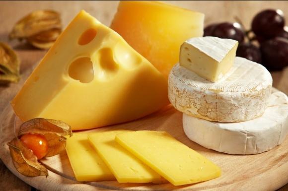 Україна нарощує виробництво сиру фото, ілюстрація