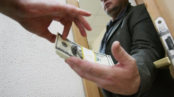 На Донеччине начальник горотдела полиции требовал у фермера 200 тыс. грн за реагирование на кражу урожая фото, иллюстрация